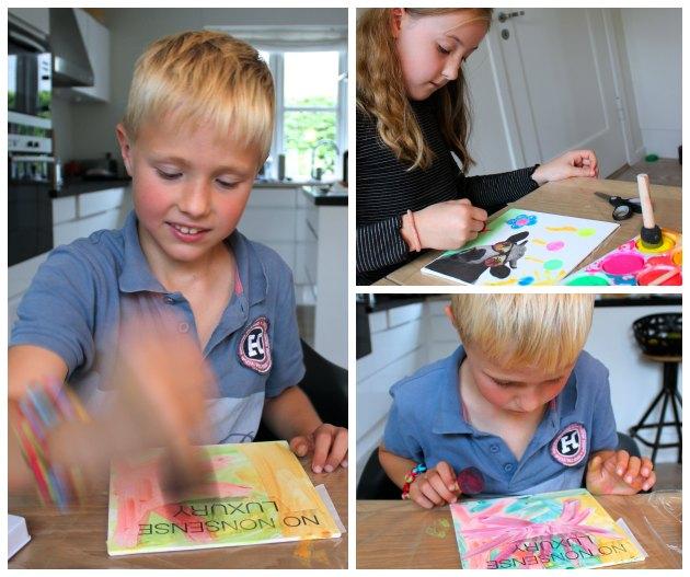 børn maler malerier til gaver med udklip og neonfarver
