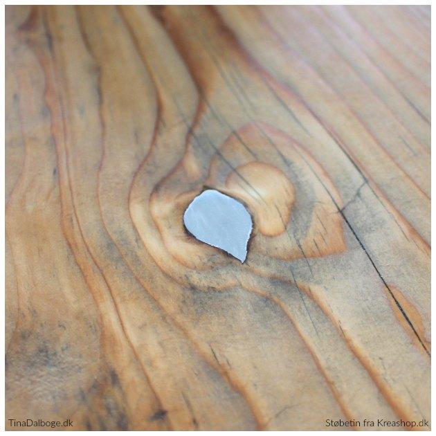 støbetin fra kreashop i knasthuller i spisebord og planker