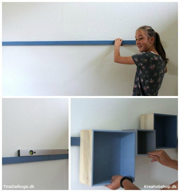 trækasser monteret på et bræt på væggen